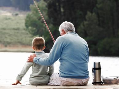 Man and boy fishing in lake