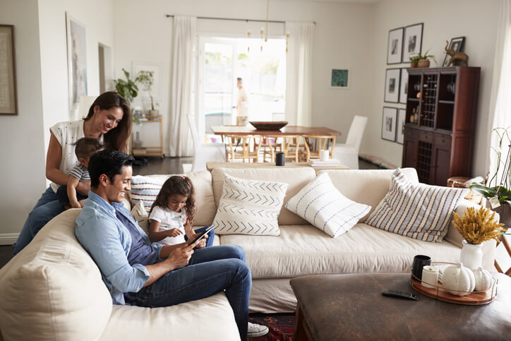 Couple and two children looking at a tablet