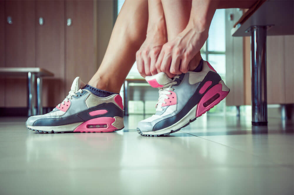 putting on running gym shoes