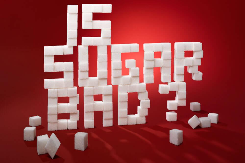 Sugar cube stacked asking is sugar bad