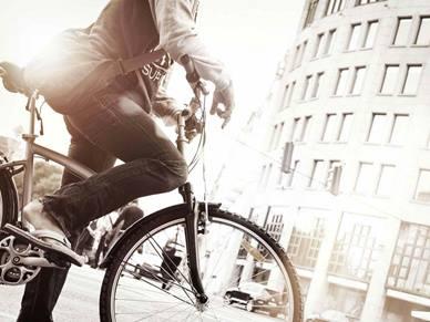 cycling beside buildings