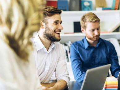 men in a office meeting