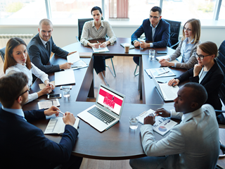 Business people sitting around a table