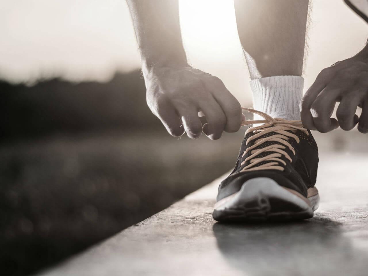 Man tying shoelace