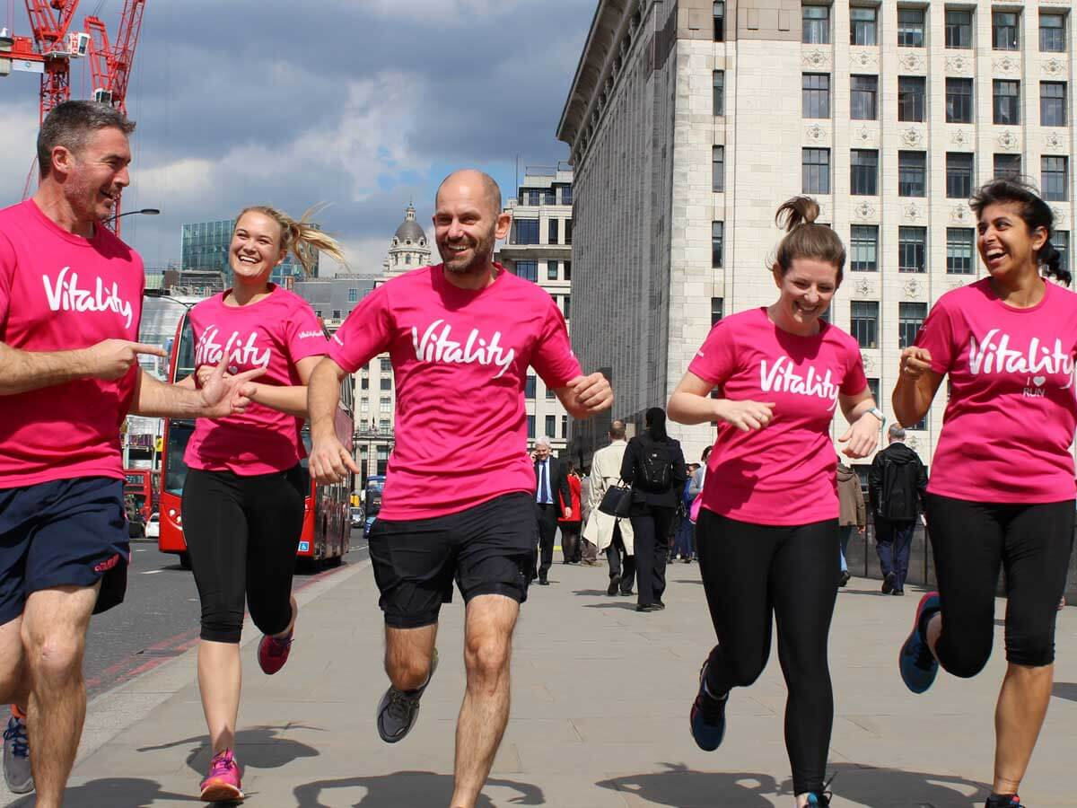 People running in pink Vitality shirts