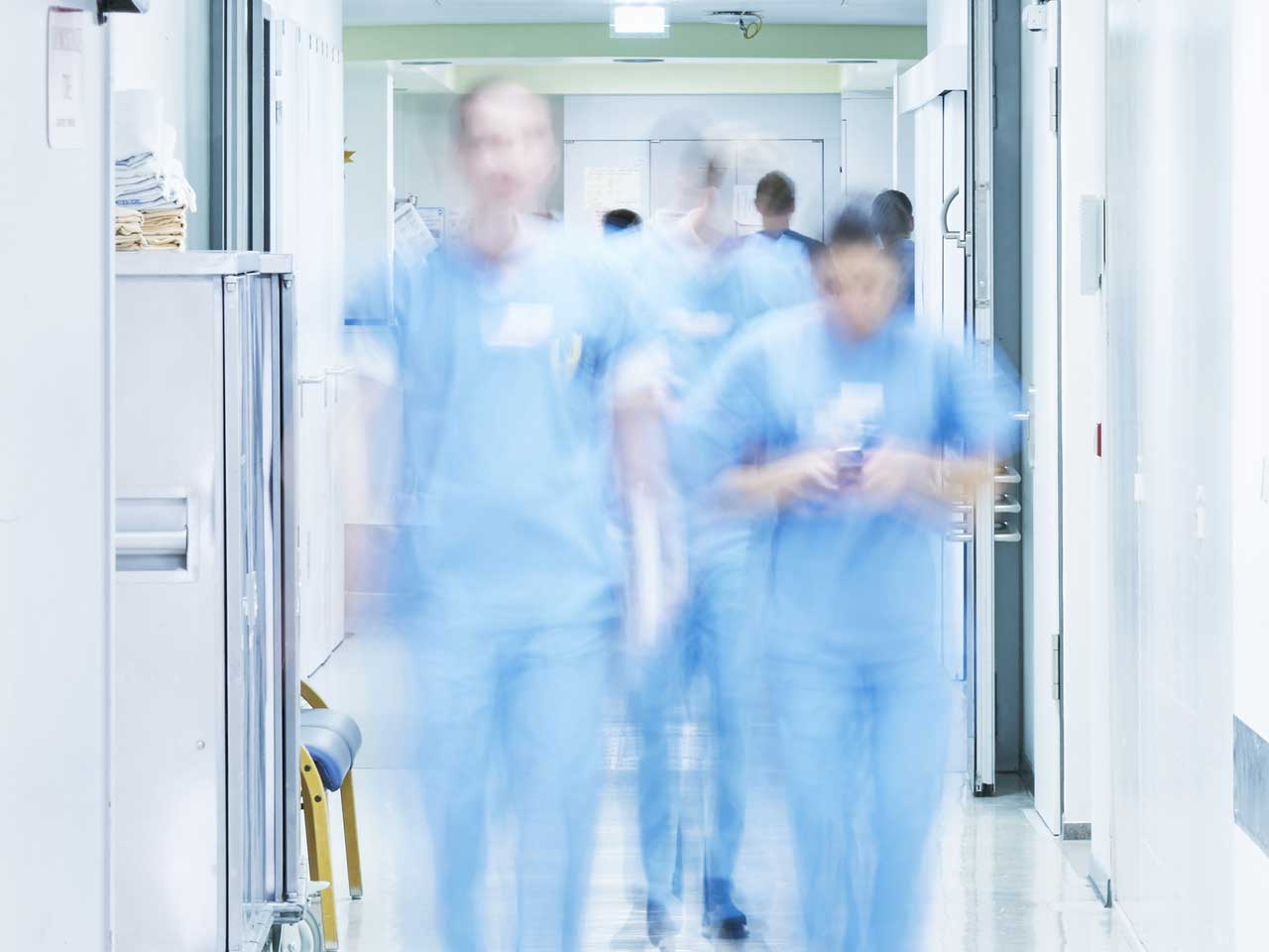 doctors walking along hospital corridor