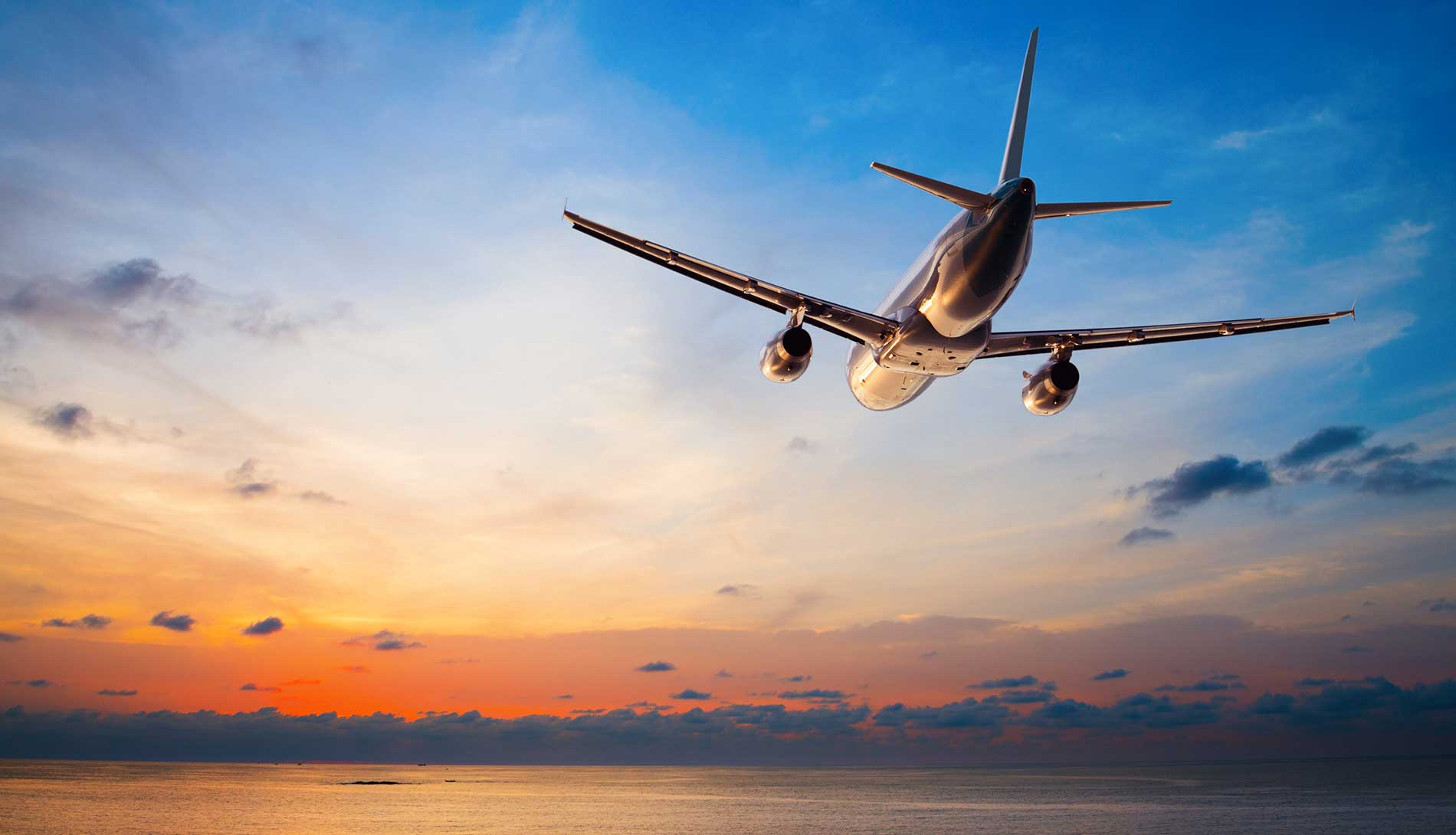 Plane flying during sunset