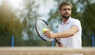 Man with tennis racquet