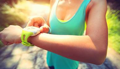 Woman looking at fitness tracker on her wrist