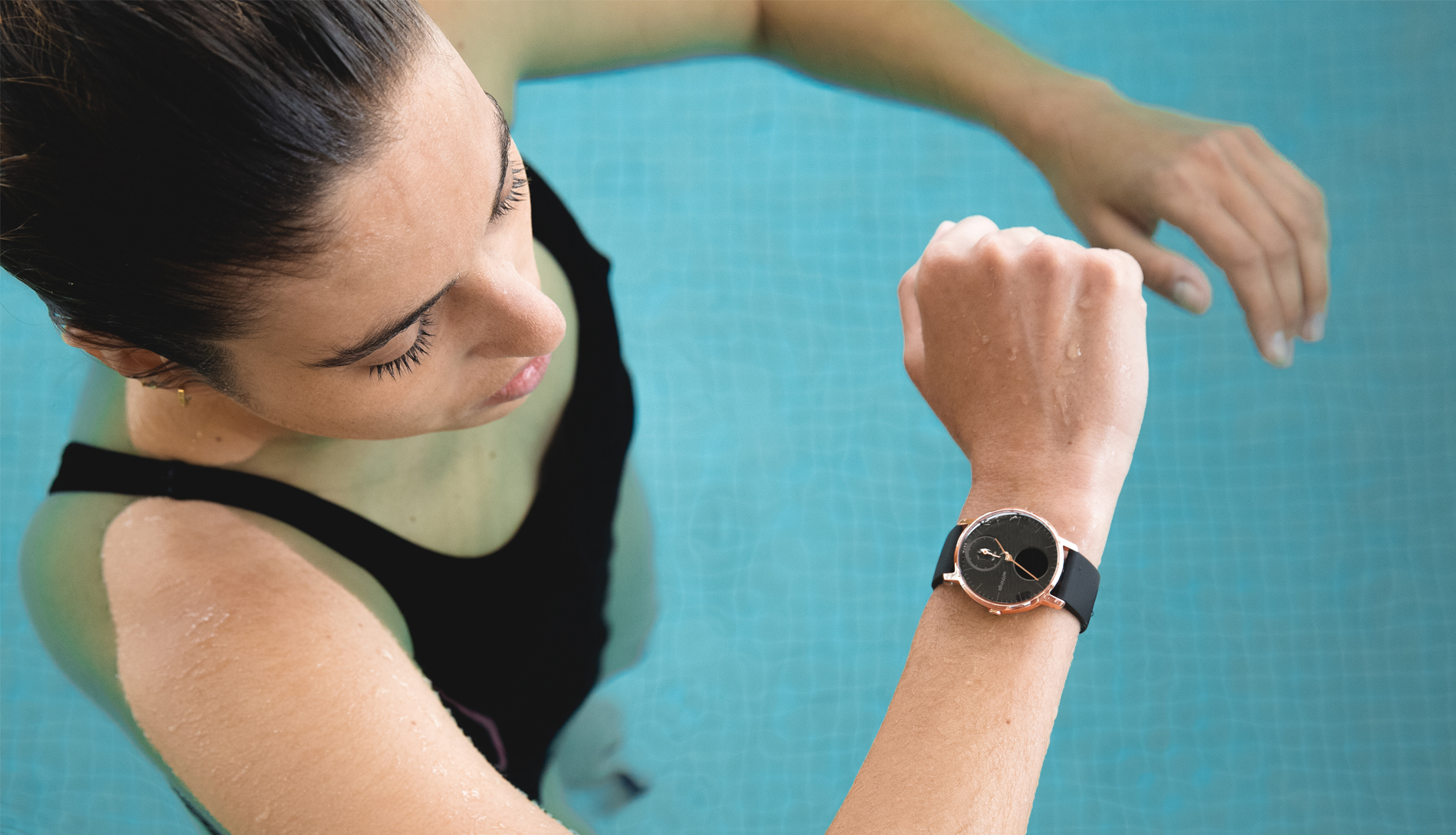 Woman swimming wearing Withings Steel watch