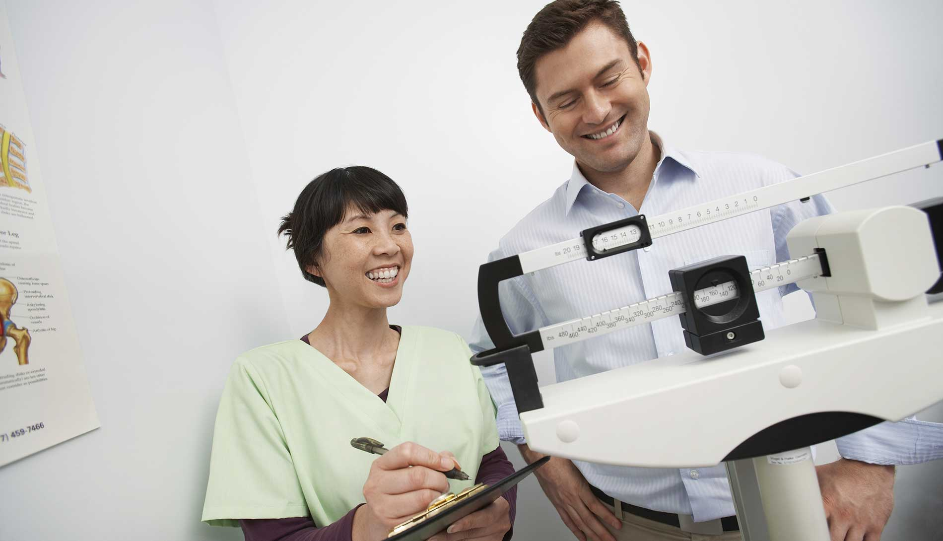 Doctor weighing male patient