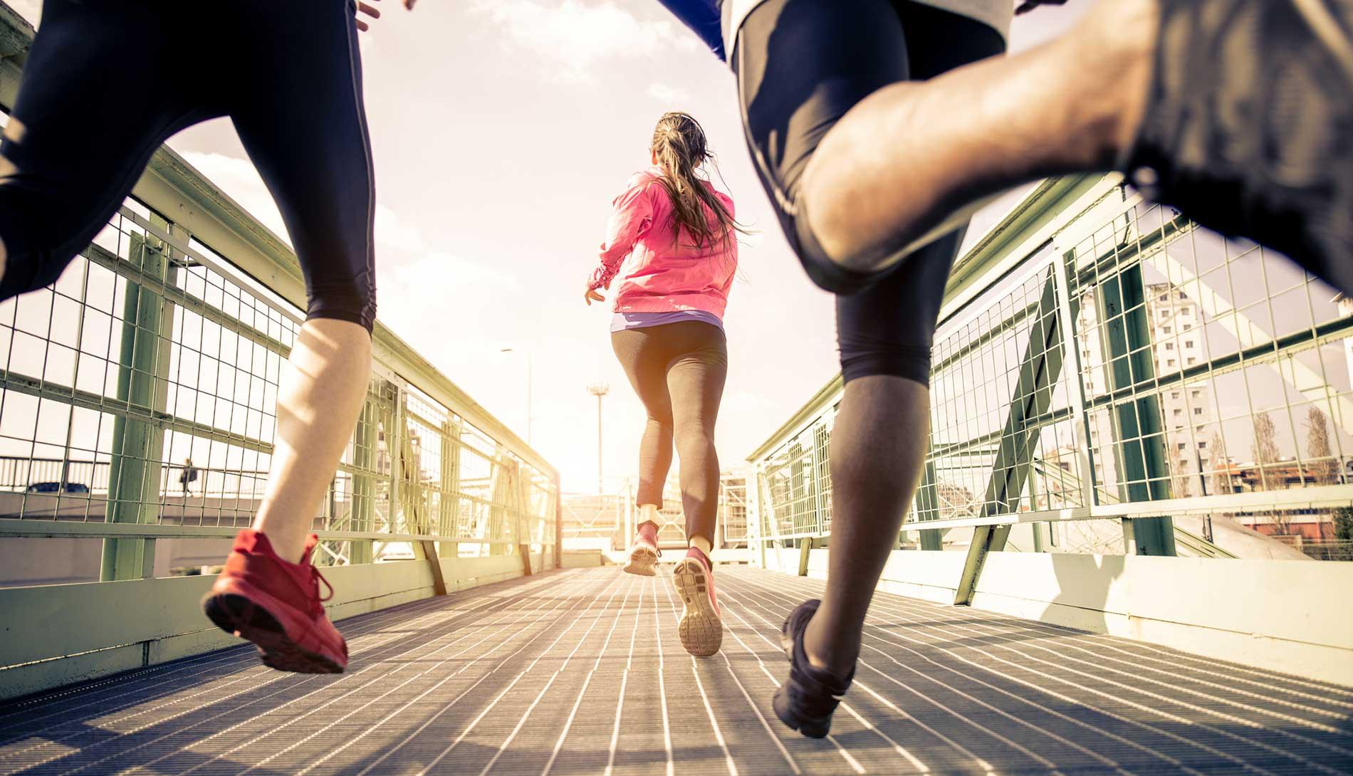 Runners across bridge