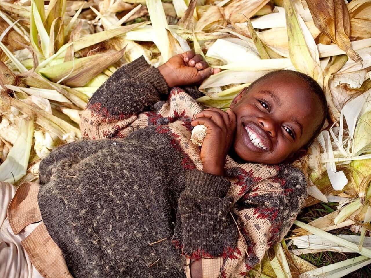 child lying in a field