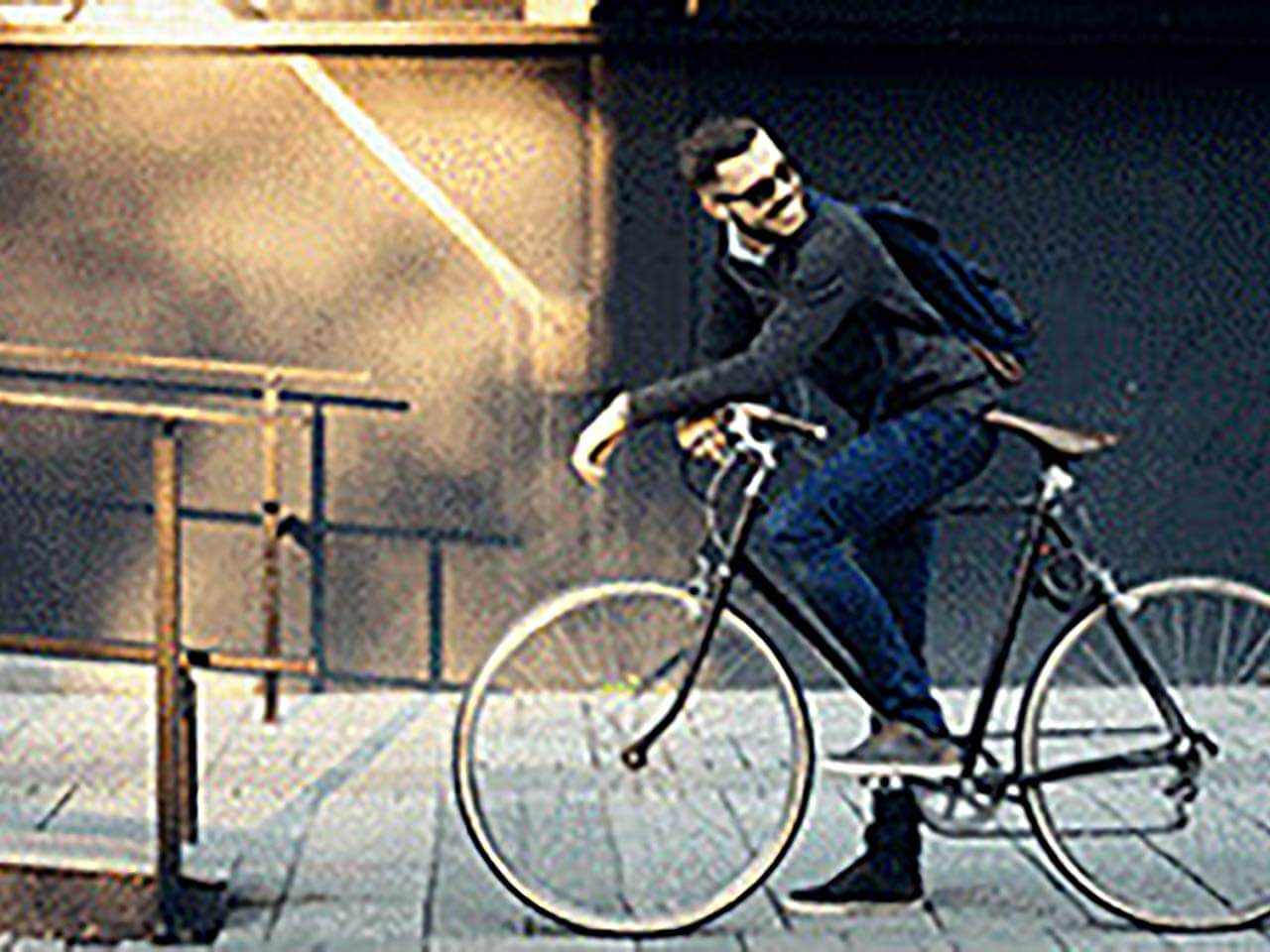 man cycling to work