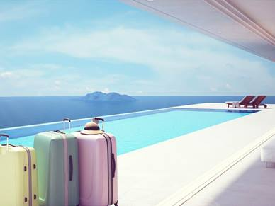suitcases by a swimming pool