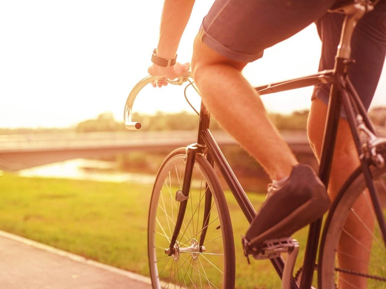 Man cycling along path
