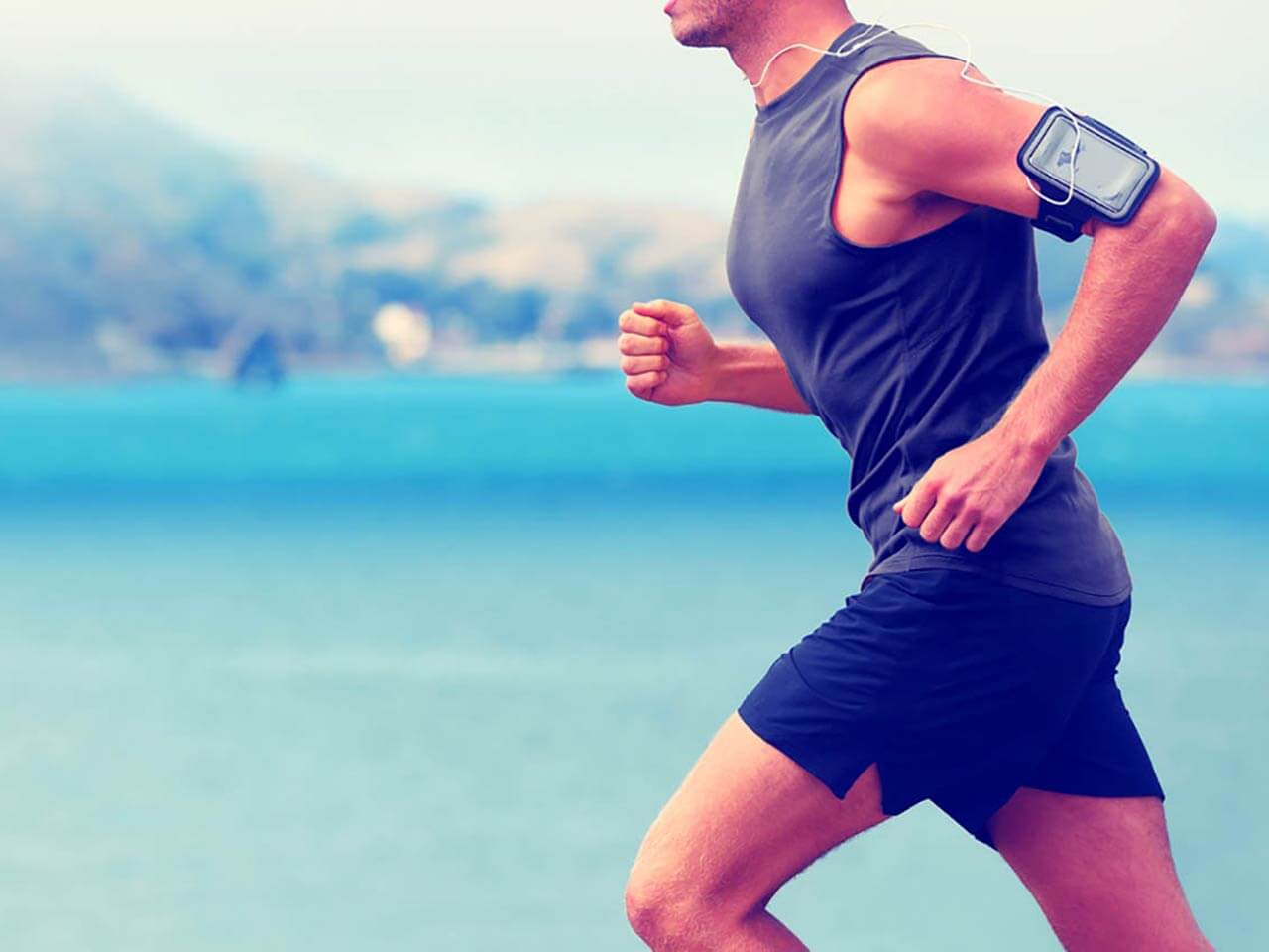man wearing a tracking device running