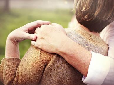 retired couple hugging