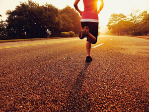 Lady running along road