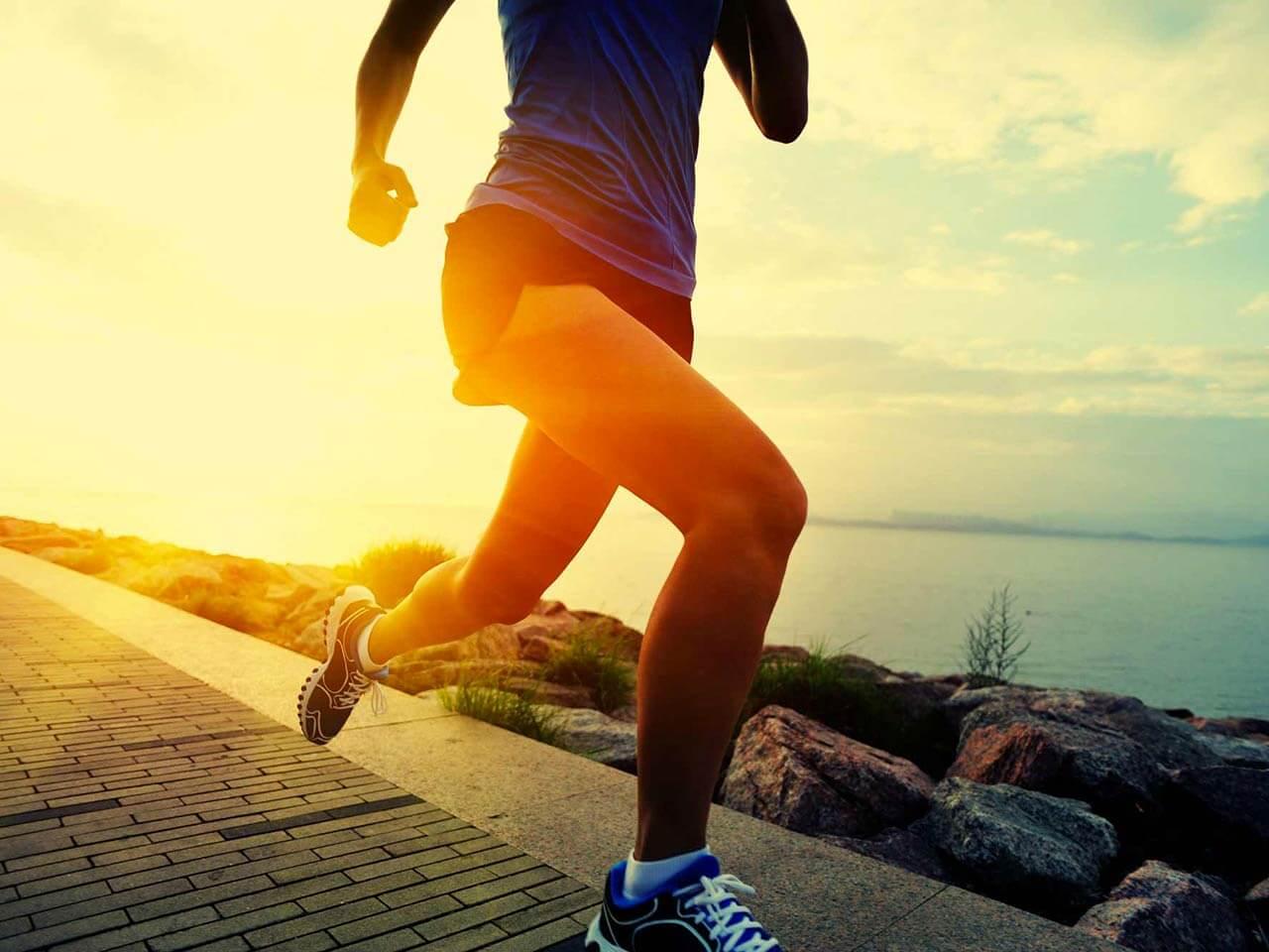 Person running along seaside