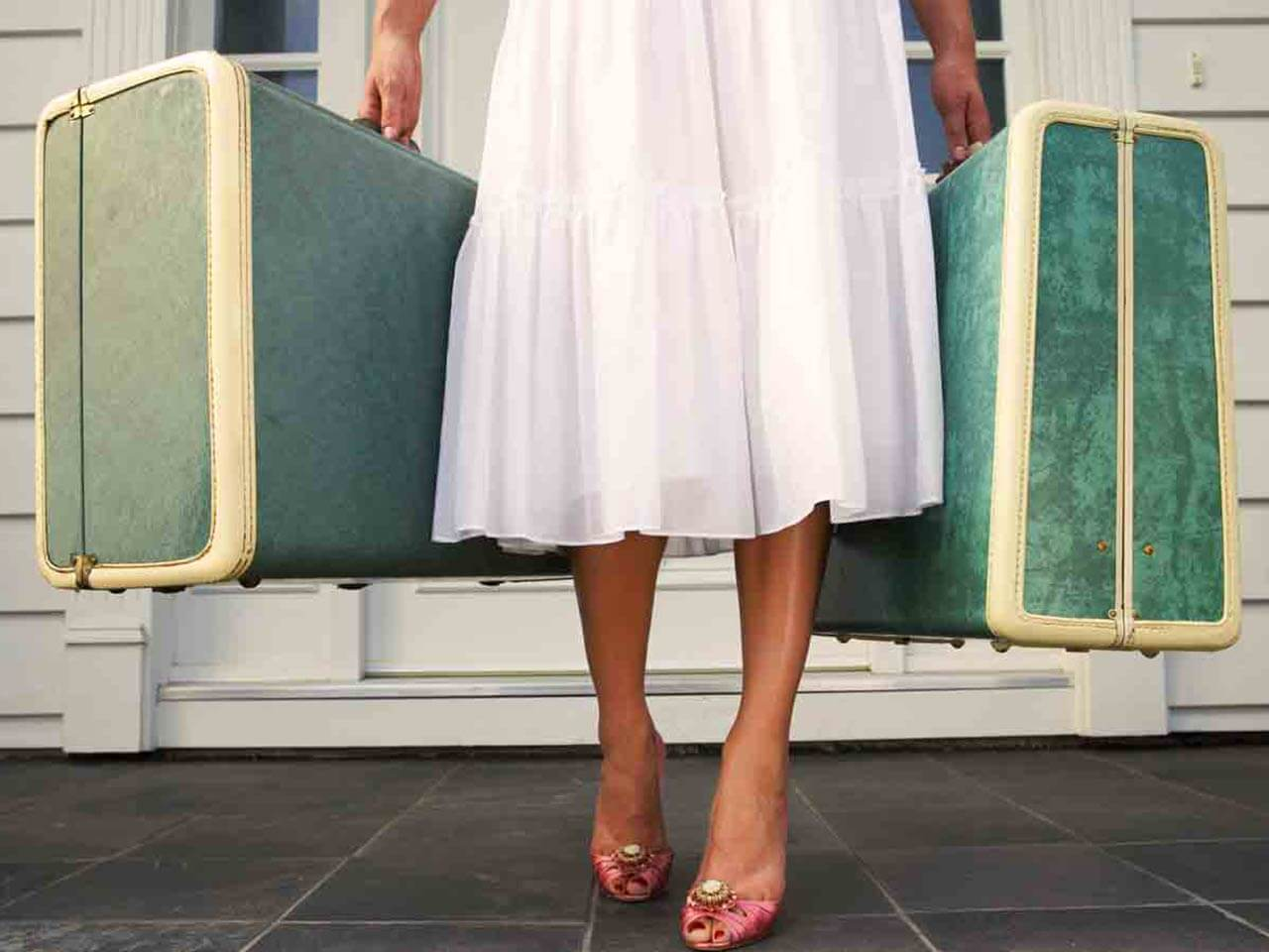 lady holding suitcases