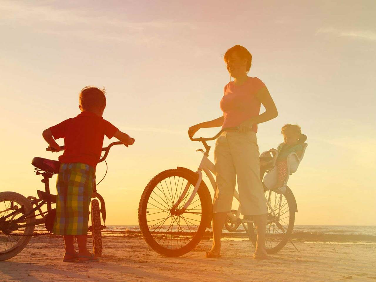 Woman and children on bikes