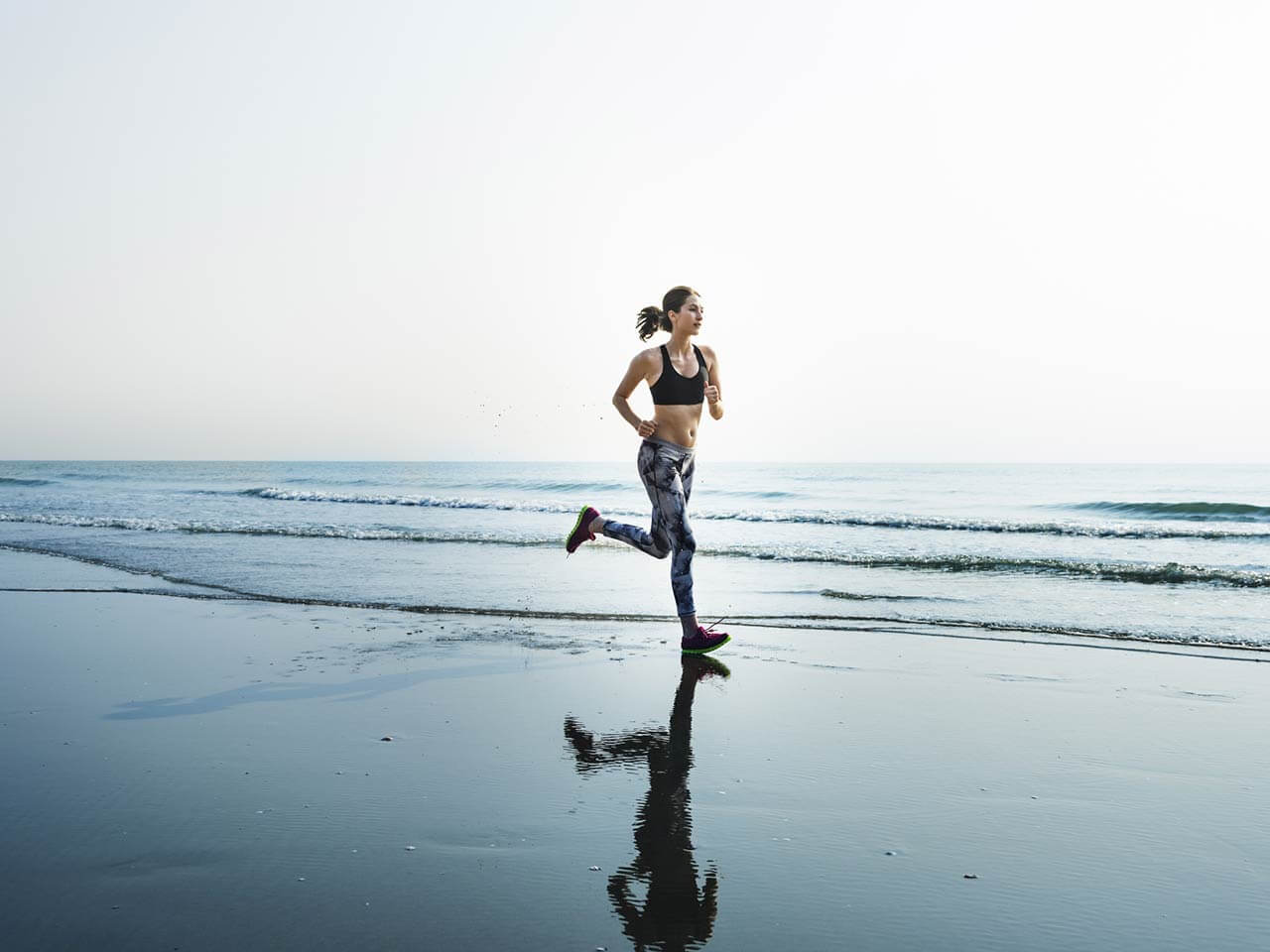 woman running along beach