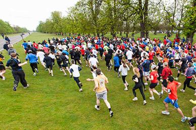Aerial view of people running in park