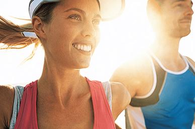 Woman and main running in sunshine