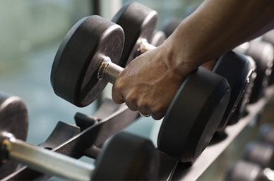 Hand lifting a dumbell