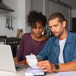 Couple researching on their laptop