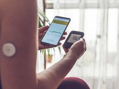 A person checking their diabetes on their phone