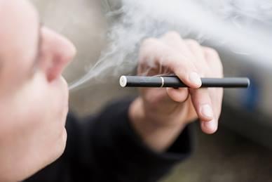 Close-up of a man smoking a vape