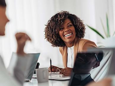 Woman laughing with her colleagues in the office