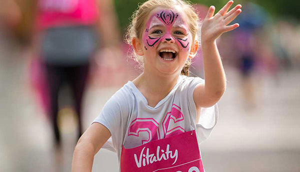 Girl with facepaint running
