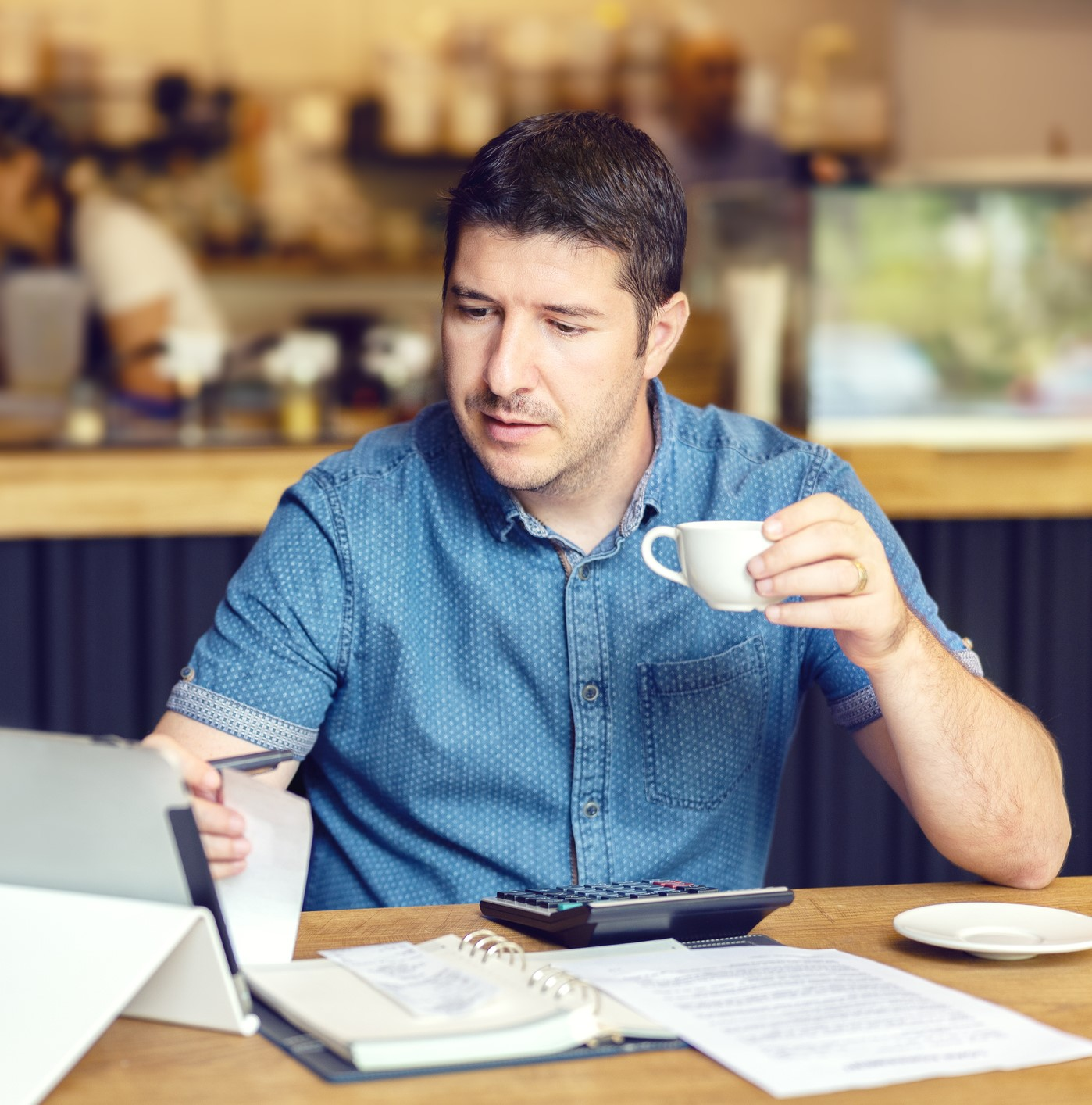 man working in the coffee shop