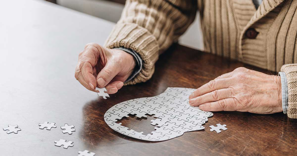 Person completing a puzzle