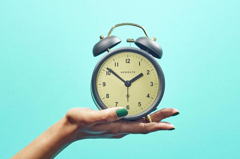 A hand holding a clock