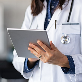 Decorative image of a doctor checking her notes