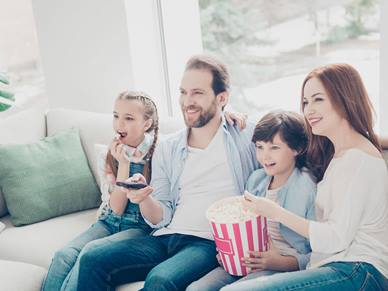 Decorate image of family watching TV