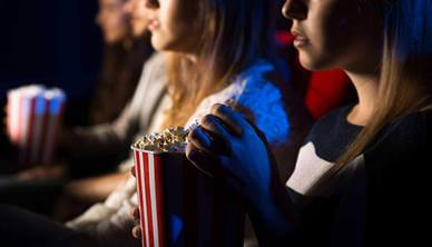 People eating popcorn in cinema