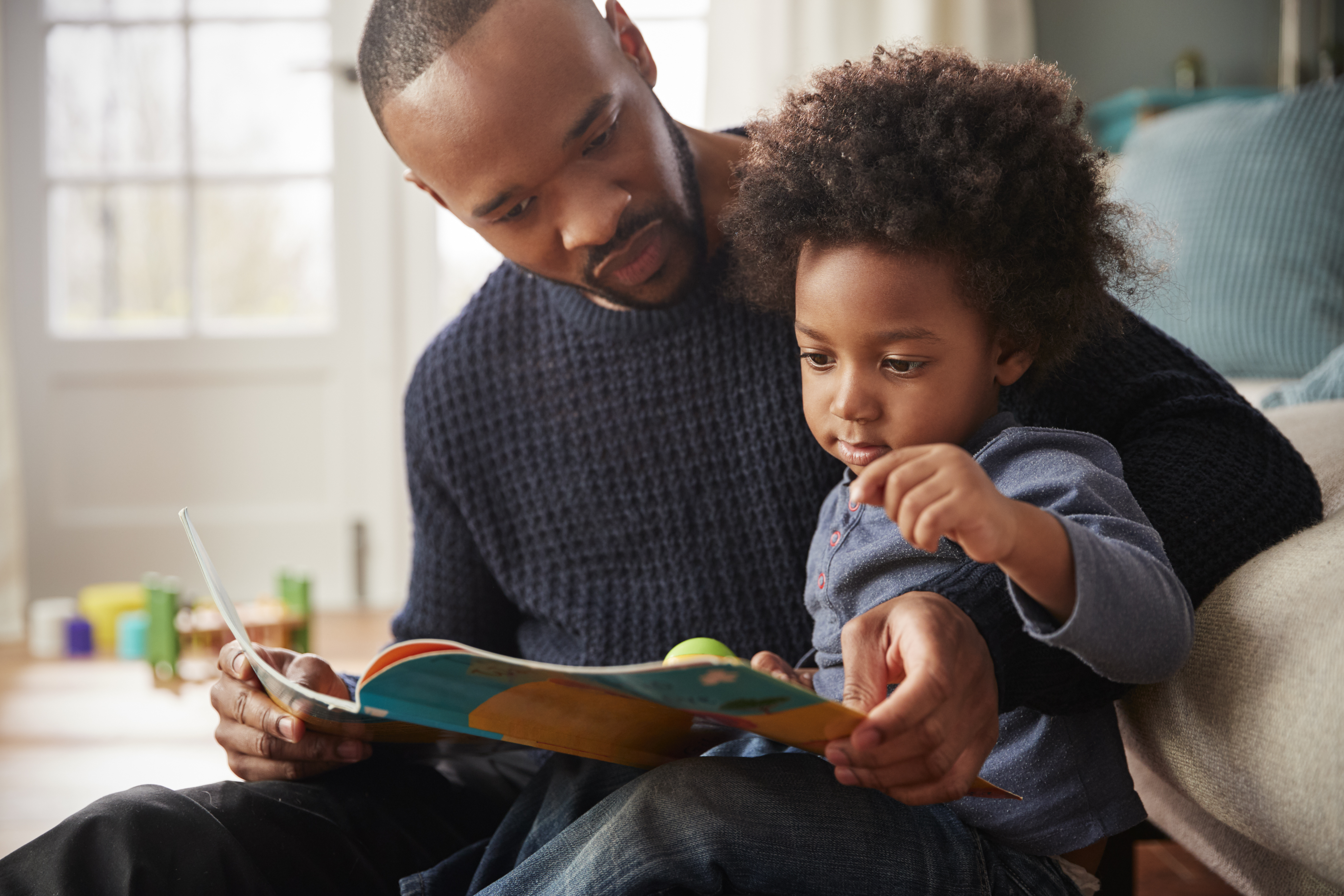 father and son read