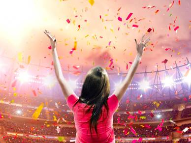 woman celebrating in sports stadium