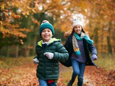 Decorate image of two children running in the forest