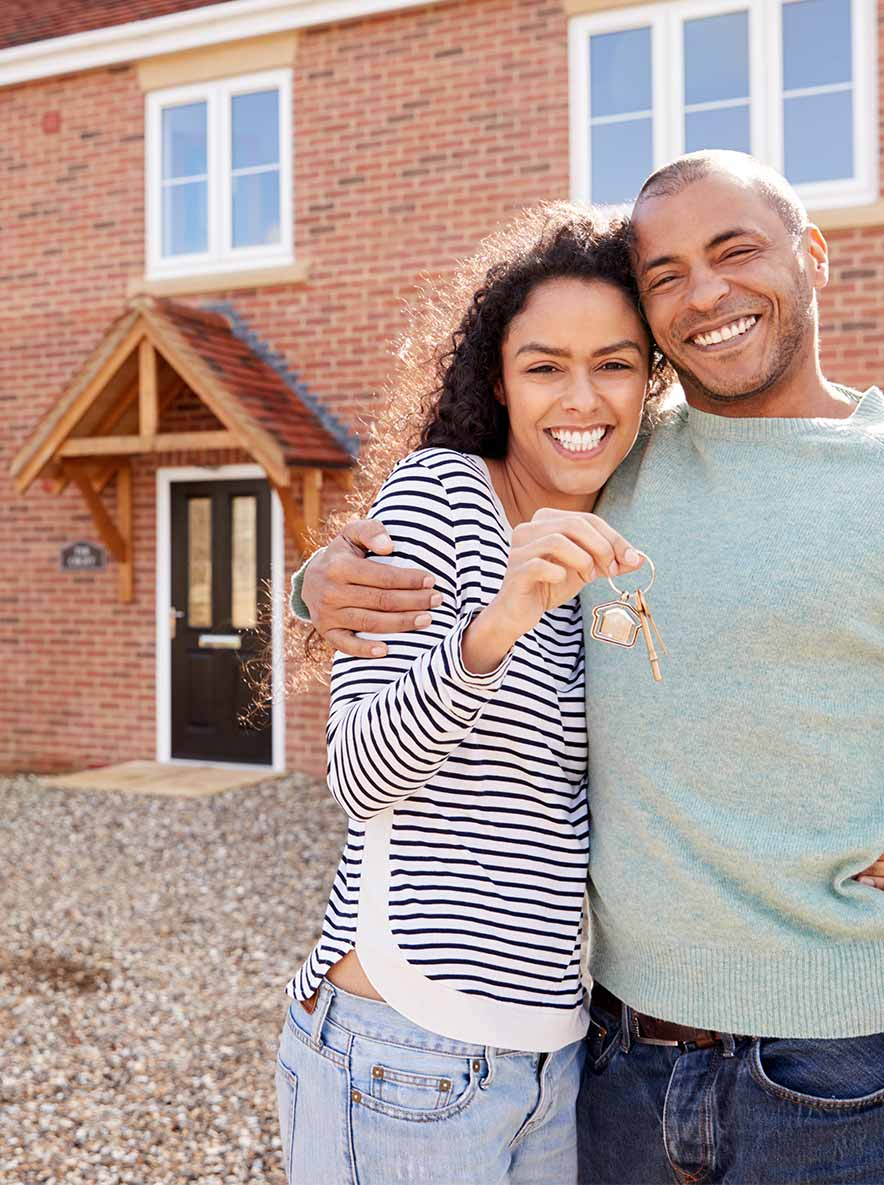 Decorate image of a happy couple outside their new home